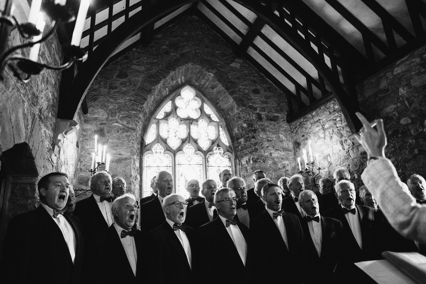 Welsh wedding photography of Male Welsh Voice choir in St Edwens Church Anglesey