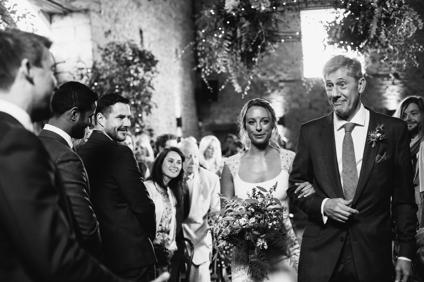 Bride walks up the aisle at Cripps Barn wedding Lucy Little Photography