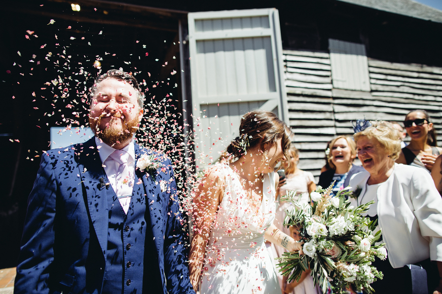Bride and Groom with confetti, Pimhill Barn wedding photography
