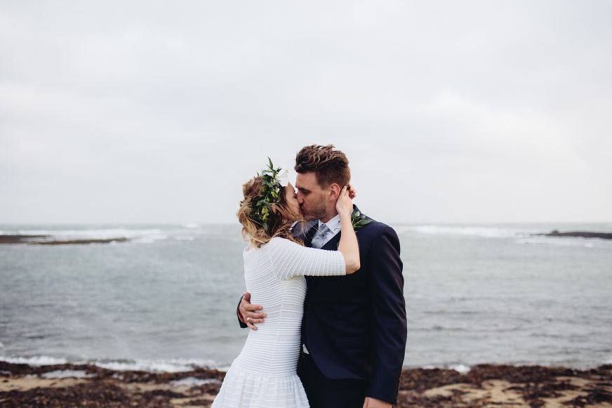 Anglesey beach wedding bride and groom kiss