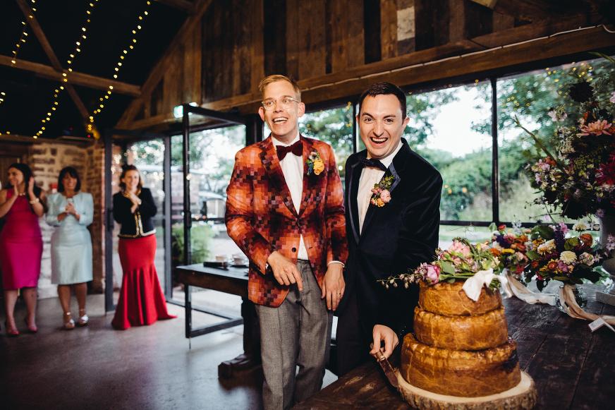 Dewsall Court same sex wedding photography velvet jacket pork pie cake