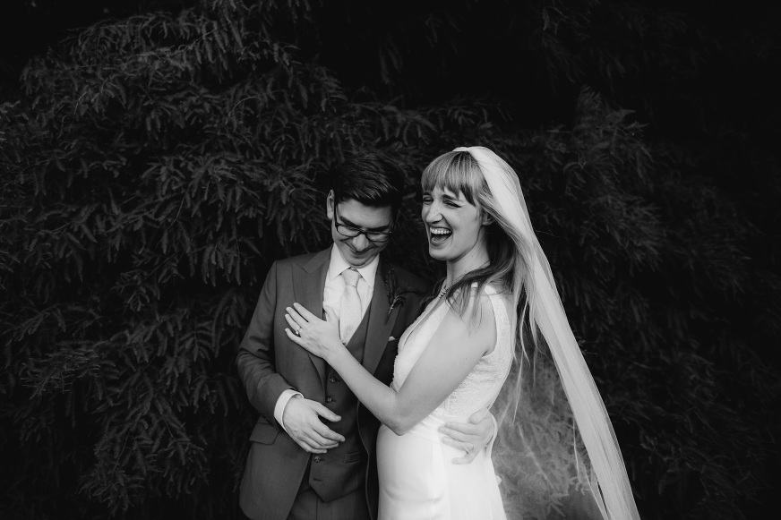 BRIDE AND GROOM LAUGHING AT BELLE EPOQUE WEDDING PHOTOGRAPHY KNUTSFORD LUCY LITTLE